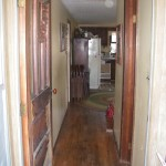 hallway to from back porch east entrance to dining room and kitchen